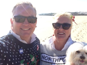 On the beach in our New Christmas Jumpers